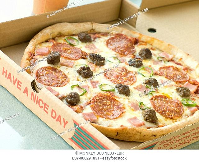 Meat Feast Pizza in a Take Away Box
