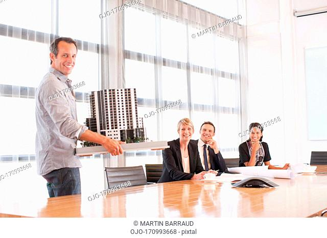 Business people with model building