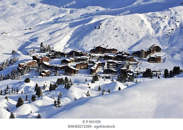snowbound ski resort in the sunshine seen from a mountain slope, France, Savoie, Belle Plagne