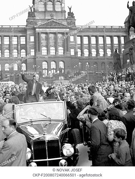 Czechoslovakia - Prague, 1950. Emil Zatopek, multiple Olympic gold medal winner waves to crowd from Horch convertible on Wenceslas square