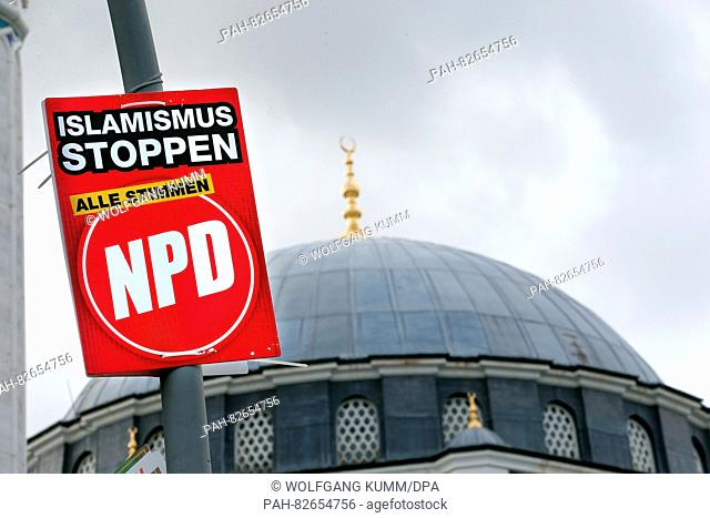 A placard from far-right party NPD is hanging on a lampost in front of the Sehitlik Mosque in Berlin, Germany, 10 August 2016
