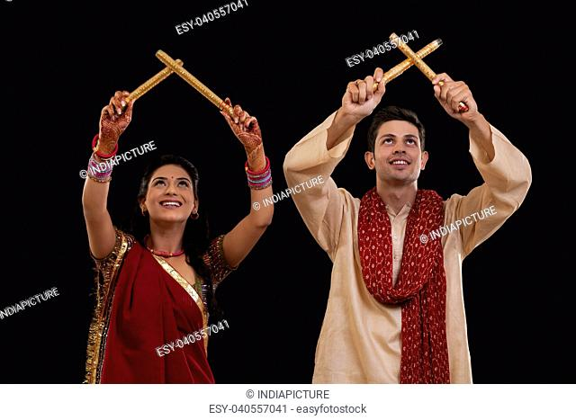 Couple with sticks dancing