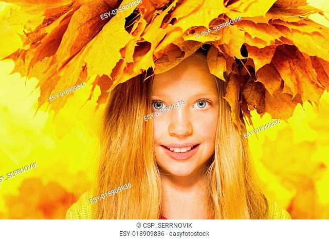 Beauty portrait of little girl in maple wreath