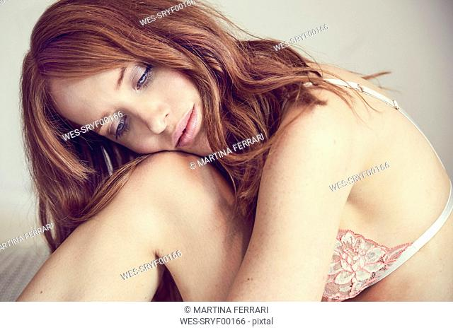 Portrait of daydreaming redheaded woman