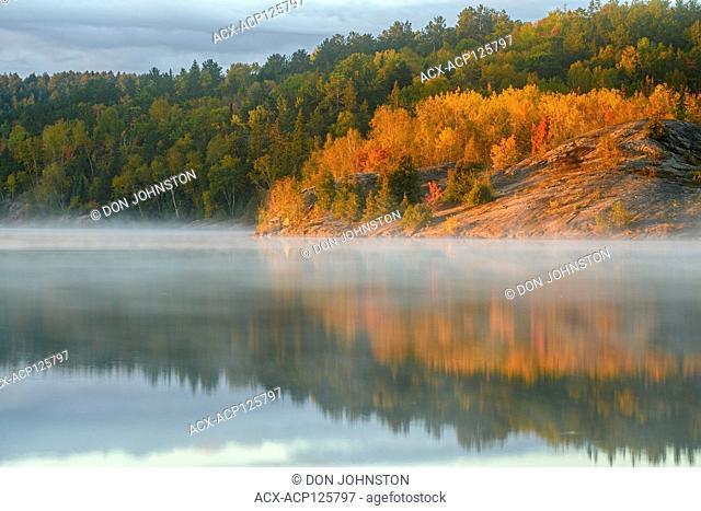 Autumn reflections in Simon Lake at dawn, Greater Sudbury, Ontario, Canada