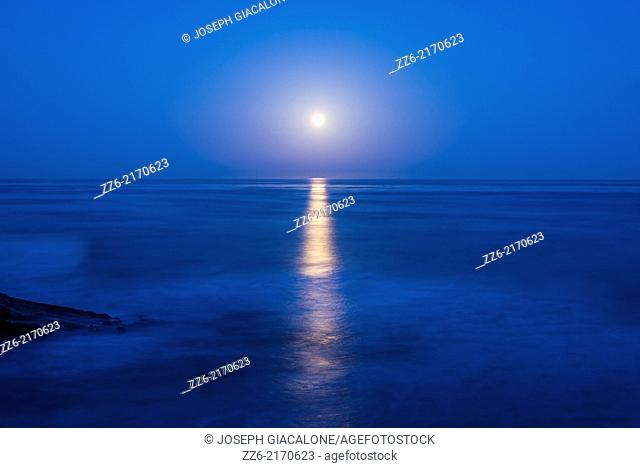 The Moon setting over the Pacific Ocean. Photographed from Sunset Cliffs Natural Park. San Diego, California, United States