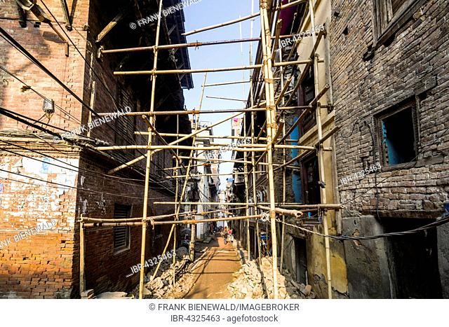 Damaged houses are stabilized by bamboo poles after the 2015 earthquake, Kathmandu, Nepal