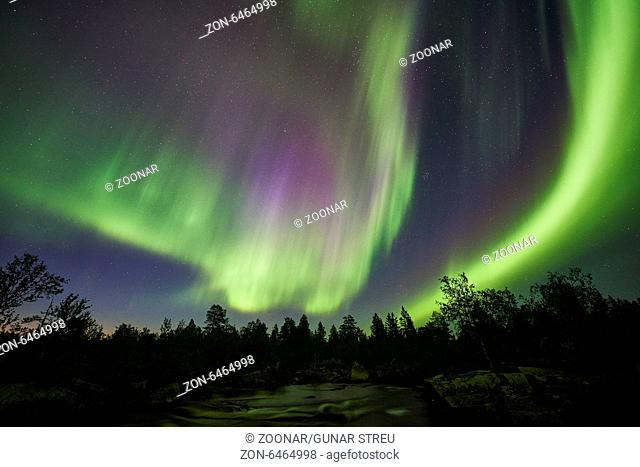 Northern lights above a creek, Lapland, Sweden