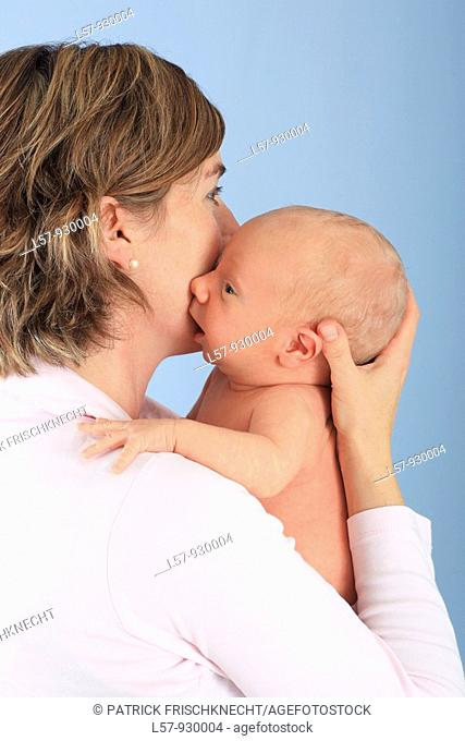mother with new born baby child, Studio shot