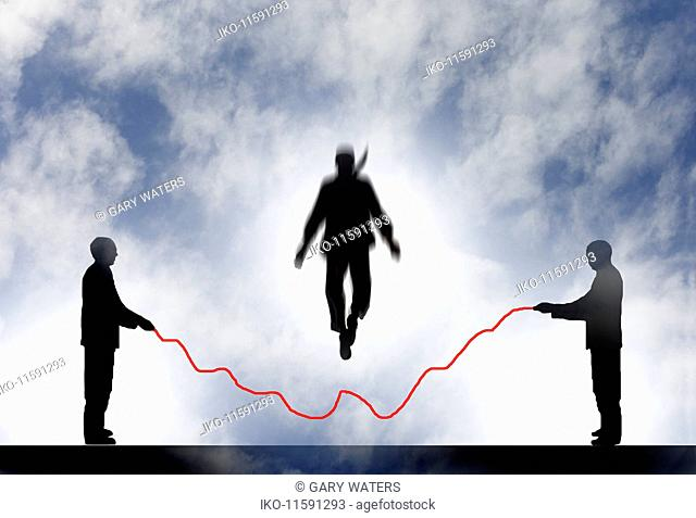 Businessman jumping over line graph skipping rope