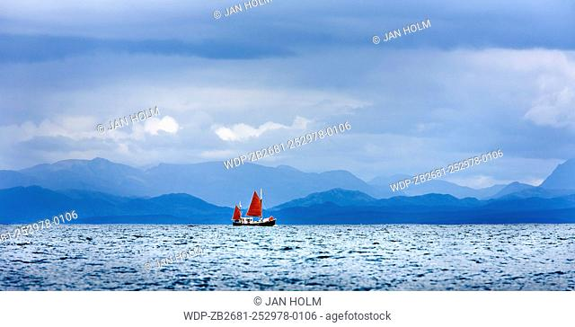 Sloop with red sails in Ardnamurchan ,Scotland
