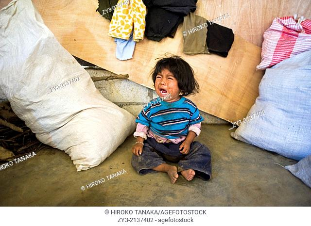 A Guatemala indigenous child in the poorly built house in Aqua Escondida in Solola department in Guatemala