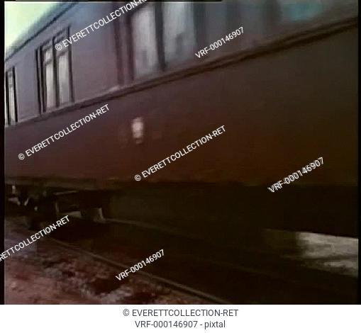 Train traveling down railroad track