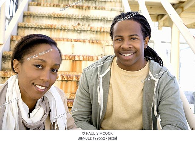 Black couple sitting on staircase