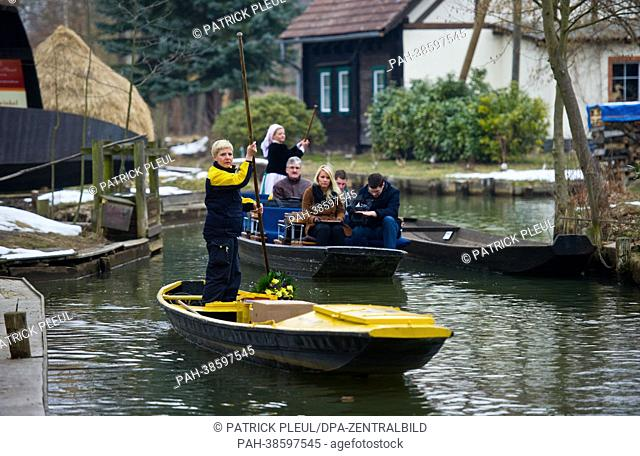 Postal worker Andrea Bunar delivers mail with a yellow post boat along a stream near Lehde, Germany, 05 April 2013. On the same day