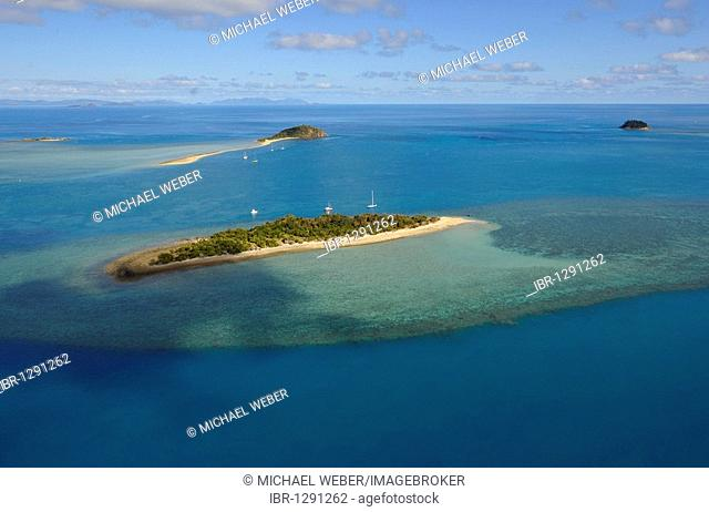 Aerial view of Black Island in front of Langford Island, Whitsunday Islands National Park, Queensland, Australia