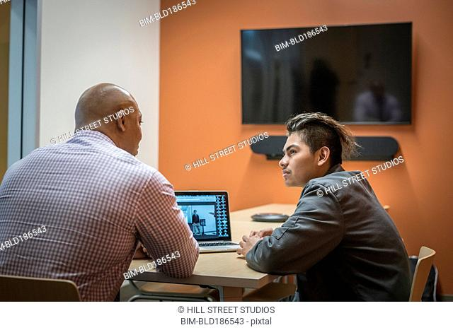 Businessman mentoring student in office meeting