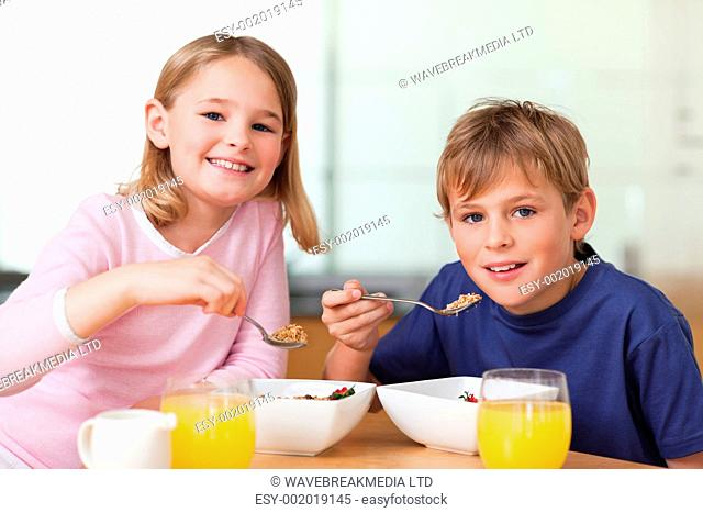 Children having breakfast in a kitchen