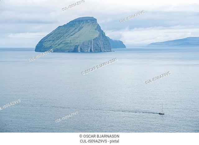 Boat on ocean by Vagafjordur, Faroe Islands