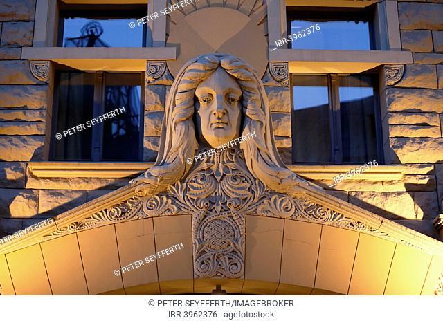Sculpture of a woman's head over the Art Nouveau entrance of the Neiburgs Hotel, Riga, Latvia