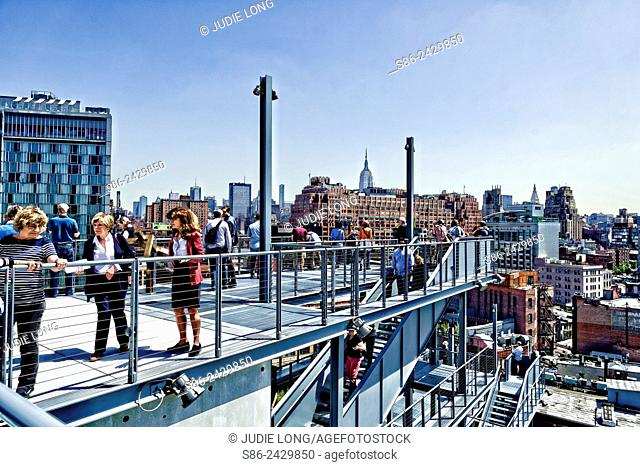 People enjoying the Outdoor Terraces on many levels, at the Whitney Museum Meatpacking District, New York City. Building designed by Renzo Piano, architect