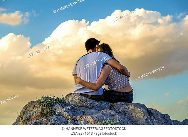 Couple in an embrace on the Areopagus hill, Greece
