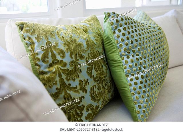 Green throw pillows on white sofa