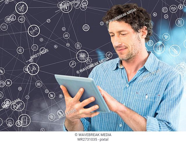 Man using digital tablet against connecting icons