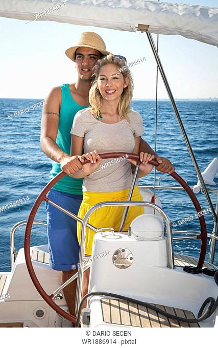 Croatia, Adriatic Sea, Young couple on sailboat
