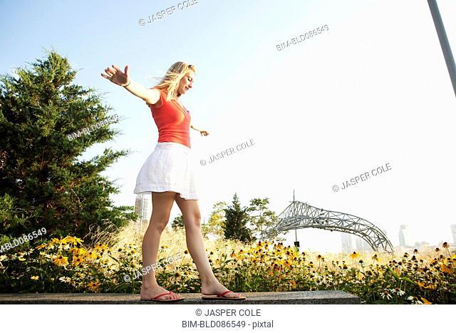 Caucasian teenager balancing on bench