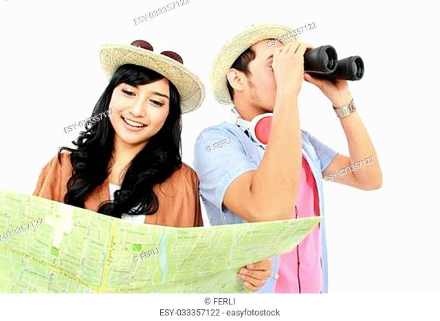 Happy teenagers tourist one look at map and each other seen with binoculars
