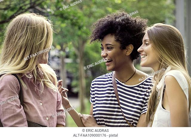 Young women laughing together outdoors