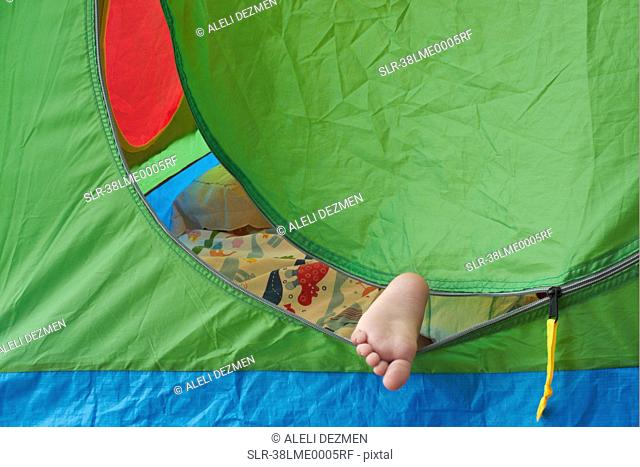Toddler?s foot sticking out of tent