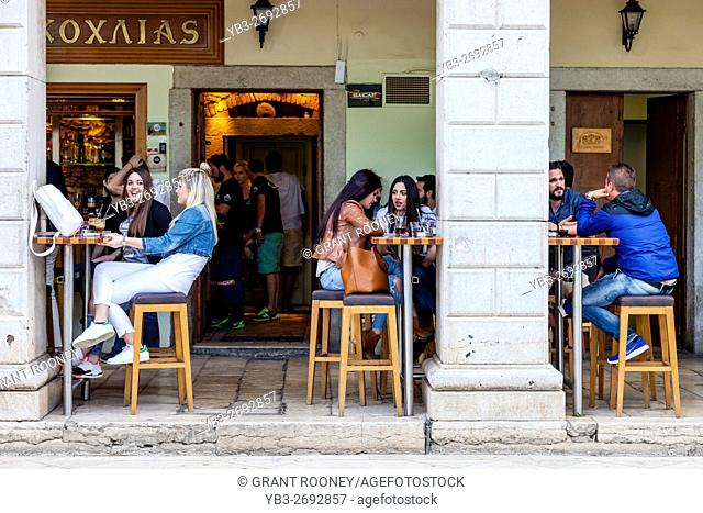 Young People Drinking Coffee At A Cafe In The Fashionable Liston Area, Corfu Old Town, Corfu, Greece