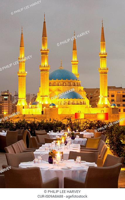 A restaurant terrace at Le Grays hotel overlooking Mohammad Al-Amin Mosque at Martyrs Square in Beirut, Lebanon