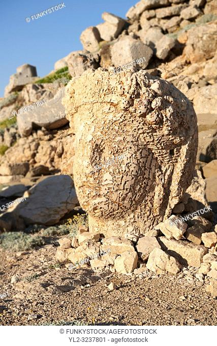 Statue head of Commagene in front of the stone pyramid 62 BC Royal Tomb of King Antiochus I Theos of Commagene, east Terrace, Mount Nemrut or Nemrud Dagi summit
