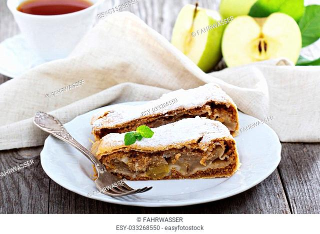 Traditional apple strudel with raisins dusted with powdered sugar
