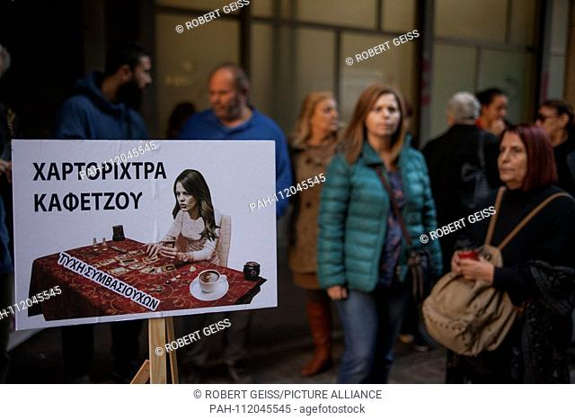 """Cleaners of public hospitals while protesting against possible layoffs. Shield """"""""Fortune Teller Effie Achtsioglou (Minister of Labor)"""""""". 22.11"""