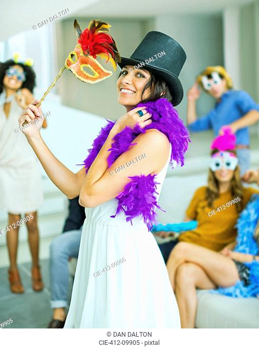Woman wearing decorative hat with mask at party