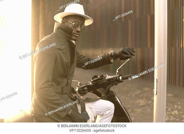 man sitting on bike, stylish, fashionable