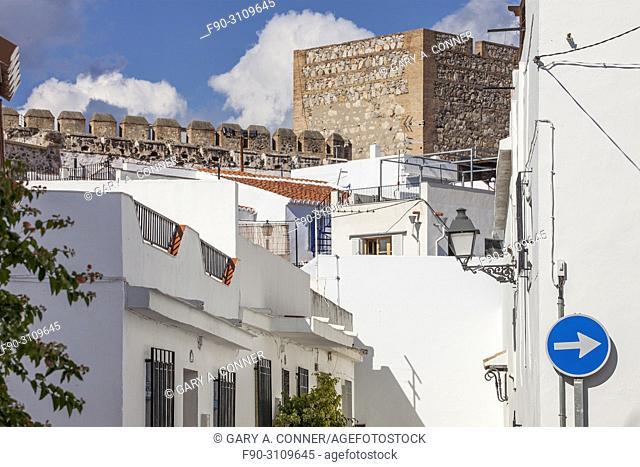 Typical stree view with castle walls in Salobreña, Granada, Spain
