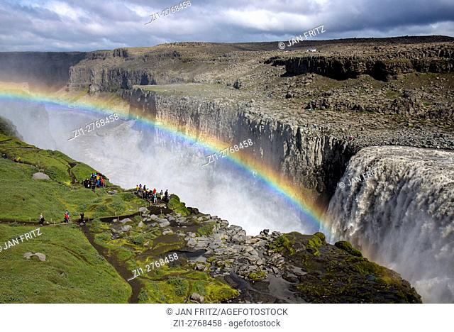 Dettifoss waterfall with rainbow at Iceland