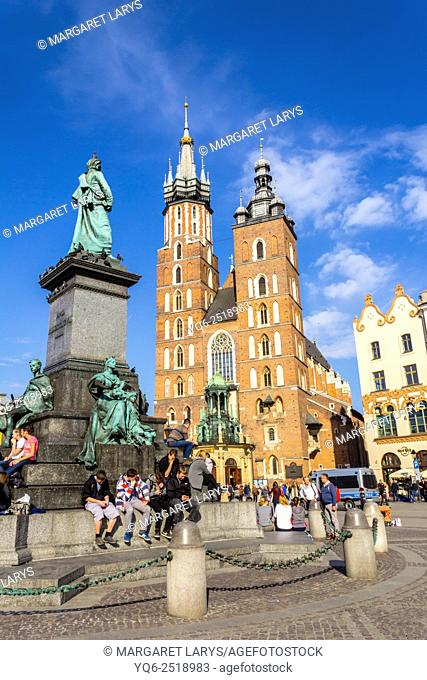 Mariacki church with Adam Mickiewicz monument at the Main Square in Krakow, Poland, Europe