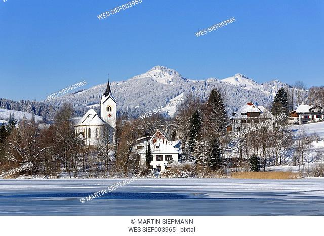 Germany, Bavaria, View of Weissensee village and lake near Fussen
