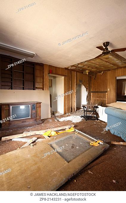 A destroyed living room inside an abandoned house in the District of Parry Sound in Ontario, Canada