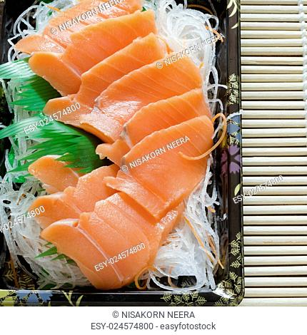 fresh salmon piece for sushi on wood background