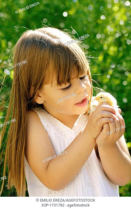 Little girl and chick
