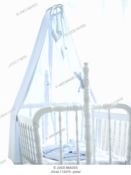 Empty cot in nursery