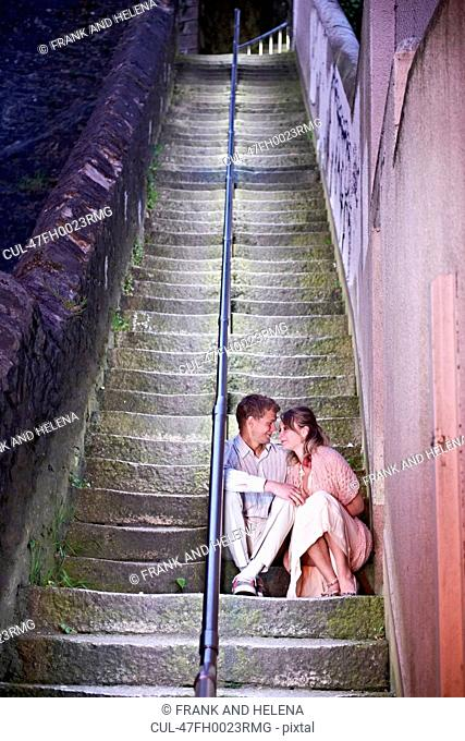 Couple sitting on urban steps