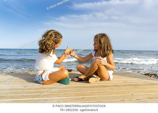 Girls playing on the beach, Alcocebre, Spain